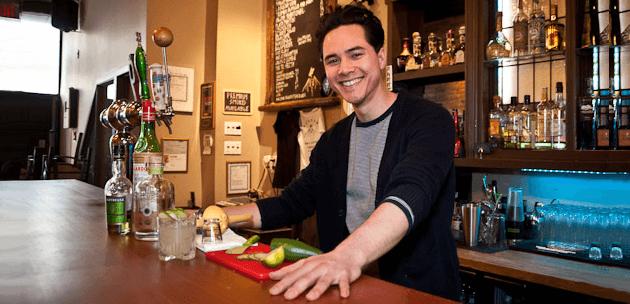 Friendly bartender using interpersonal customer service skills