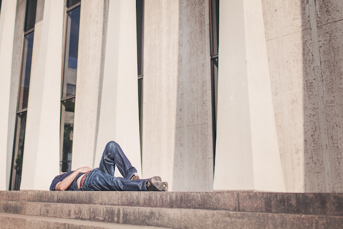 man lying stairs burnout syndrome